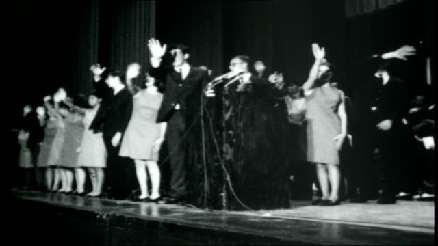 the beatles across america; ellis auditorium: people singing song on stage at religious rally sot - バンド アメリカ点の映像素材/bロール