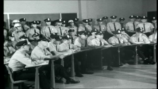 the beatles across america tennessee memphis ext county hall building / shelby county sign police officers being addressed by senior policeman about... - 1966 stock-videos und b-roll-filmmaterial