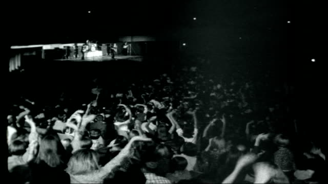the beatles across america usa int the beatles performing on stage in america fans waving and screaming - 1966 stock-videos und b-roll-filmmaterial