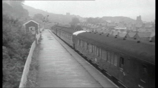 the way to braybrook street the life of harry roberts air view train along through countryside train along wales monmouthshire llanbradach station... - 1966 stock videos and b-roll footage
