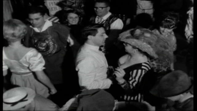 vidéos et rushes de west germany: pre-lent carnival festivities; girls in fancy dress lead parade with high kicks at final fasching ball princess speaking into mic at... - demi finale