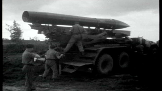 west germany's role in nato; various shots of british troops on exercise with honest john missile, assembling missile, counting down, missile being... - 西ドイツ点の映像素材/bロール