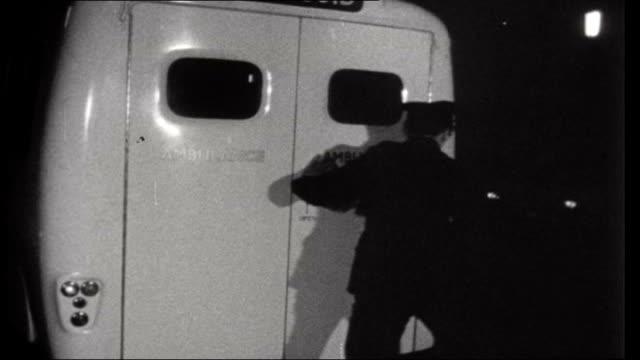 car insurance england travelling shot of mini car along dark road/ reconstrcution of car crash person on stretcher carried into ambulance int... - 自動車ブランド mini点の映像素材/bロール