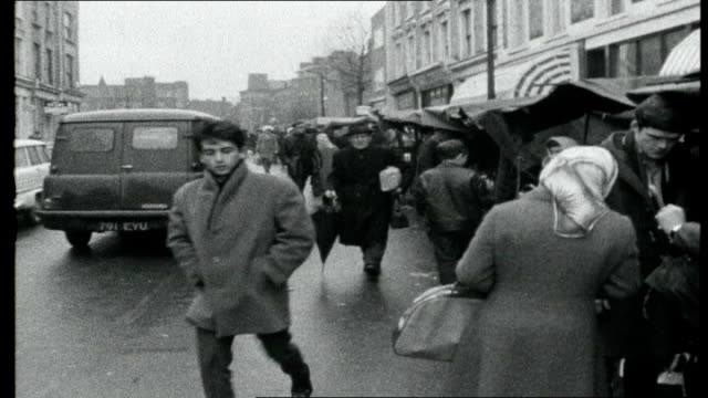 england kinky uniforms metropolitan police officers along past young men dressed in military jackets / police officers questioning men about their... - jimmy perry stock videos and b-roll footage