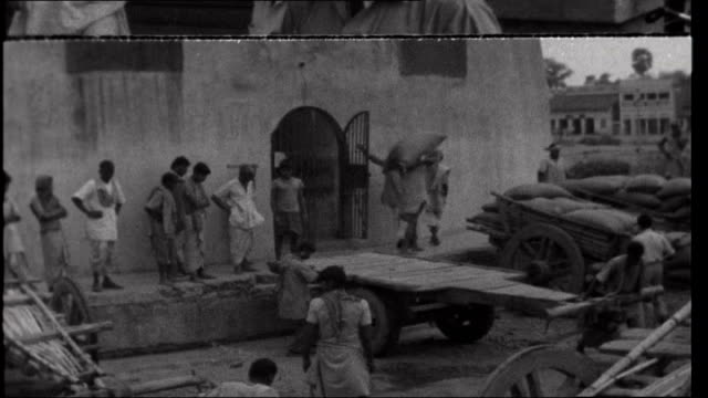 Famine in Bihar EXT Exterior shots of State Parliament building Civil Servants arriving at parliament building carrying files Exterior shots of giant...