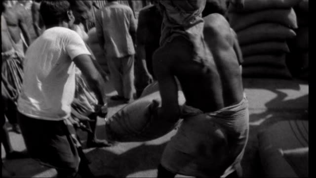 famine in bihar india bihar gaya ext 'untouchable' child scouring ground for grains of wheat other 'untouchables' feeding off droppings from sacks of... - dalit stock videos and b-roll footage