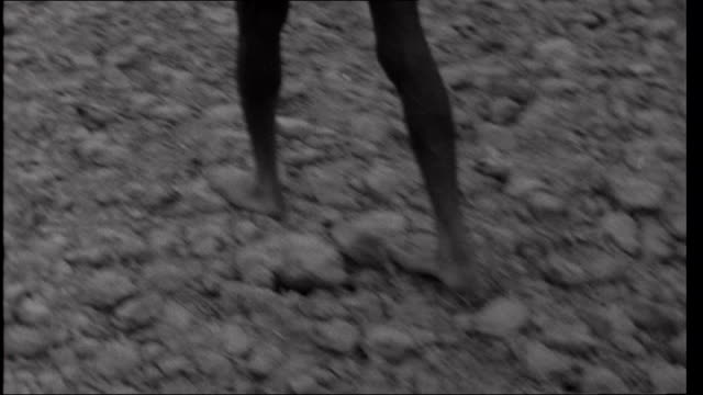 famine in bihar shots of an 'untouchable' villager called baneshwar walking barefoot over hard earth views of village where baneshwar lives including... - dalit stock videos and b-roll footage