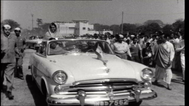 indian elections west bengal indira gandhi greeting crowds lining roadside from opentopped car during election campaign/ indiar gandhi addressing... - indira gandhi stock videos & royalty-free footage