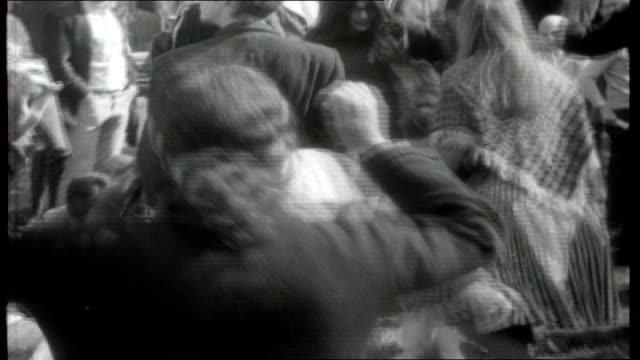 san francisco hippies ext crowds gathered for park 'happening' / hippies dancing as grateful dead band perform on stage sot / hippies sat smoking /... - haight ashbury stock videos & royalty-free footage