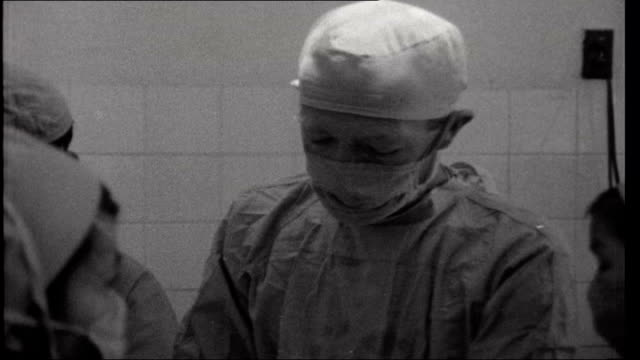vietnam refugees: civilian war victims; dr peter smith scrubbing up / patient given anaesthetic by one of medical team operating theatre / dr peter... - anesthetic stock videos & royalty-free footage
