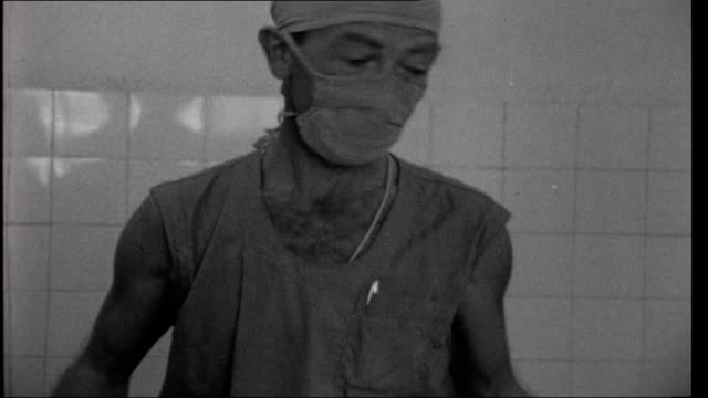 Vietnam Refugees Civilian War Victims Patient brought into operating theatre on stretcher and anaesthetic being administered Dr Peter Smith...