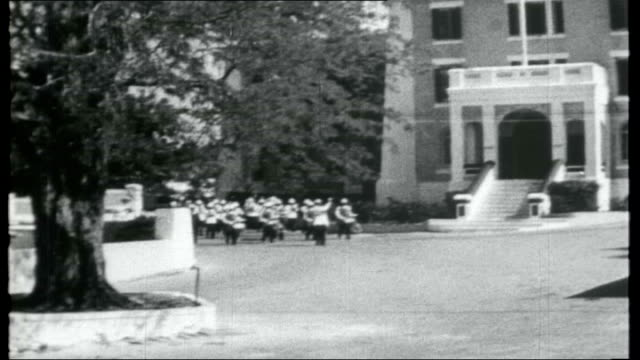 bahamas first negro government; nassau: ext military band playing in grounds of government house sot / exterior of bank building - bahamas stock-videos und b-roll-filmmaterial