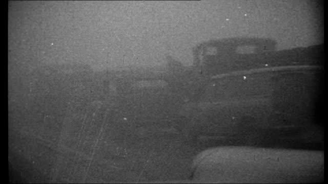 Crashes on British motorways ENGLAND Various travelling shots from front of car driving down M6 motorway in fog / Various shots of wrecked cars /...
