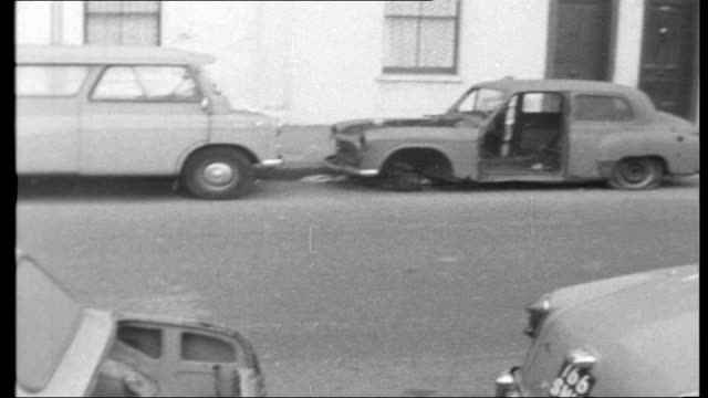 derelict cars disposal england ext high angle view of rows of brand new cars parked in car park general views of abandoned derelict cars in street... - cars parked in a row stock videos & royalty-free footage