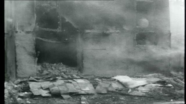 kashmir indian border fighting at srinagar kashmir buildings burning rubble of destroyed buildings / distressed women seated on ground - jammu e kashmir video stock e b–roll