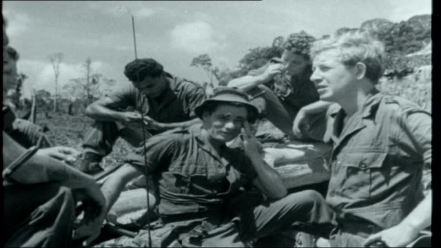 malaysian war borneo ext platoon of royal ulster rifles on patrol in borneo jungle/ soldiers in encampment on nibong hill near border/ platoon... - borneo stock-videos und b-roll-filmmaterial
