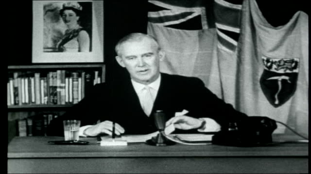 Rhodesia Britain enforces sanctions INT John Wrathall making televisied broadcast SOT