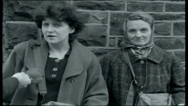 vídeos de stock e filmes b-roll de south wales miners strike; jones walking up hill in village / jones sitting on wall with friend / gvs of mountain ash village / road of terraced... - país de gales