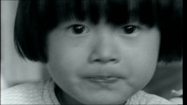 vietnam saigon at work and war int various of vietnamese children made orphans by vietnam war eating in orphanage / various of babies in orphanage /... - south vietnam stock videos and b-roll footage