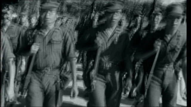 vietnam saigon at work and war south vietnamese troops marching along singing sot - south vietnam stock videos and b-roll footage