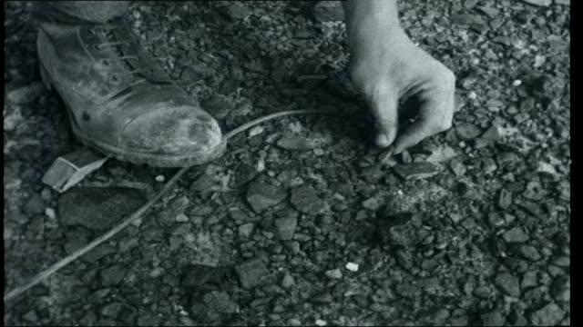yemen british troops checking dhala road for land mines using metal detectors soldiers blowing up landmine found in desert by tribesman remains of... - yemen stock videos & royalty-free footage