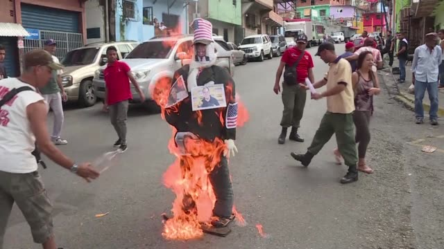 vídeos y material grabado en eventos de stock de representaciones del presidente venezolano nicolas maduro su contraparte estadounidense donald trump y otros actores de la actual crisis politica... - judas