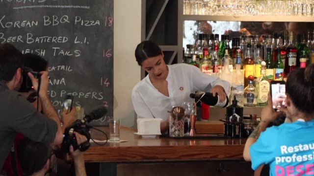 US representative Alexandria Ocasio Cortez who famously worked as a bartender in New York before being elected in Congress last year returns to her...