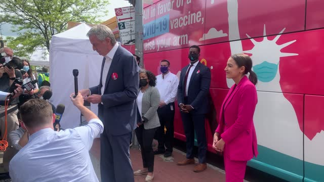 representative alexandria ocasio-cortez listens as new york mayor bill de blasio speaks during a joint visit to a mobile vaccination site in the... - brooklyn new york stock videos & royalty-free footage