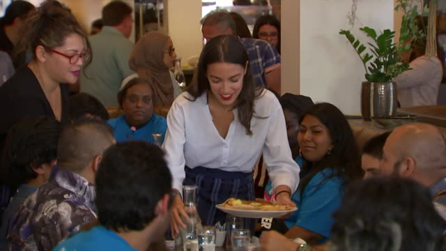 representative alexandria ocasio-cortez waits tables during an event to support raising federal minimum wage for tipped workers in jackson heights,... - united states and (politics or government) stock videos & royalty-free footage