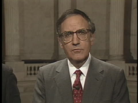 representative george mitchell discusses the role of president ronald reagan in the iran contra affair. - president stock videos & royalty-free footage