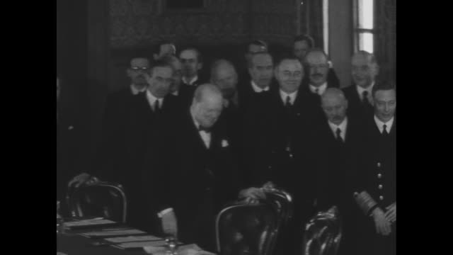 WS representatives of Commonwealth nations and Britain's allies stand in drawing room of St James's Palace during World War II conference / King...