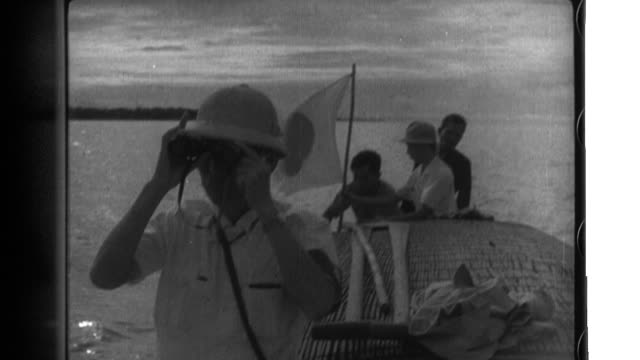 representatives of japan thailand and french indochina use boats water buffalo carts elephants and other transportation as they survey and mark a... - indochina stock videos and b-roll footage