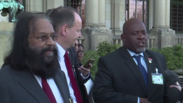 representatives of the chagos islands react with joy after the international court of justice order britain to bring an end to its administration of... - international court of justice stock videos and b-roll footage