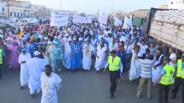 representatives of the ruling party join for the first time the mauritanians to demonstrate in the streets of nouakchott for the rights of the... - the machine: master or slave stock videos & royalty-free footage