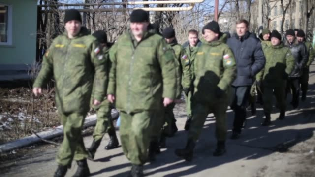 representatives of ukraine russia and organization for security and cooperation in europe hold a meeting on february 17 2015 in soledar a town 40km... - waffenstillstand krieg stock-videos und b-roll-filmmaterial