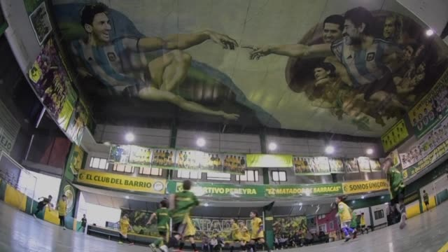 representing god and adam from the famous michelangelo sistine chapel painting diego maradona and lionel messi look down from above on the futsal... - sportivo stock videos & royalty-free footage
