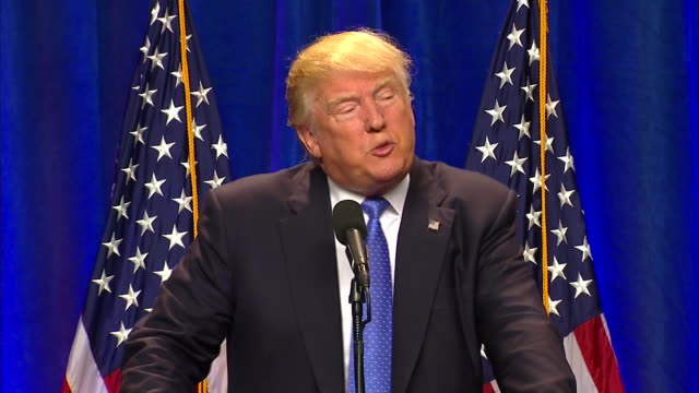 republican candidate donald trump stands at podium with american flags behind him and gives campaign speech at st. anselm college after orlando... - human rights or social issues or immigration or employment and labor or protest or riot or lgbtqi rights or women's rights stock videos & royalty-free footage