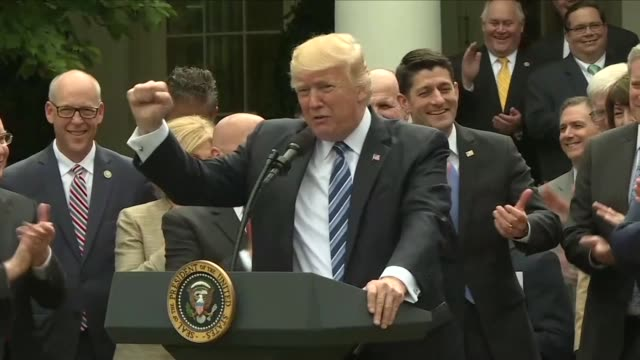 Republican congressmen join US President Donald Trump in the White House Rose Garden to celebrate after the House of Representatives narrowly passed...