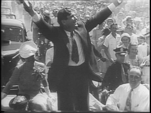 republican convention / wendell willkie at podium with hands raised / stage shot of crowds / willkie standing with arms stretched out in campaign... - human limb stock videos & royalty-free footage