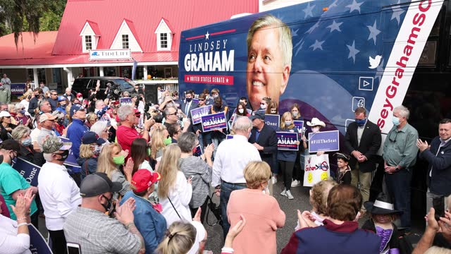 republican incumbent sen. lindsey graham speaks to supporters during a campaign bus tour stop on october 31, 2020 in pawleys island, south carolina.... - south carolina stock videos & royalty-free footage