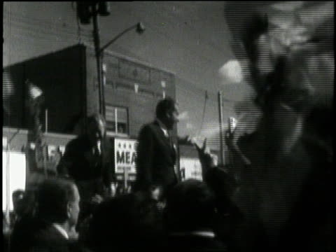 us republican presidentelect richard nixon waves to cheering crowds during a campaign stop in 1968 - richard nixon stock-videos und b-roll-filmmaterial