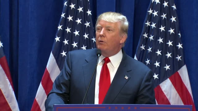 republican presidential candidate donald trump stands at podium in front of american flags at trump tower in new york city. trump gives speech... - massenvernichtungswaffe stock-videos und b-roll-filmmaterial