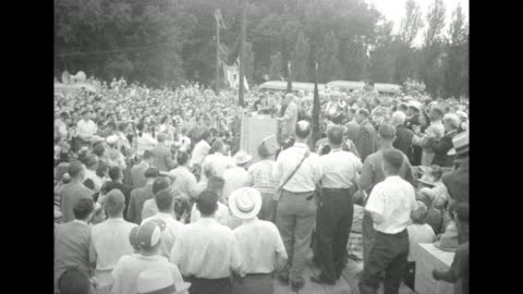 republican presidential candidate dwight d. eisenhower is slowly escorted through a large crowd with most men wearing light-colored hats / the people... - homecoming stock videos & royalty-free footage