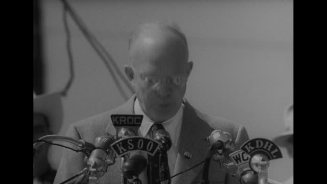 CU Republican presidential candidate Dwight D Eisenhower speaks at podium with radio microphones 'at the very moment the Democrat candidate accused...
