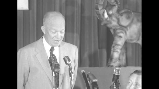 republican presidential candidate dwight eisenhower speaks at microphones on table statue of elephant behind him flashes going off / ms eisenhower... - richard nixon stock-videos und b-roll-filmmaterial