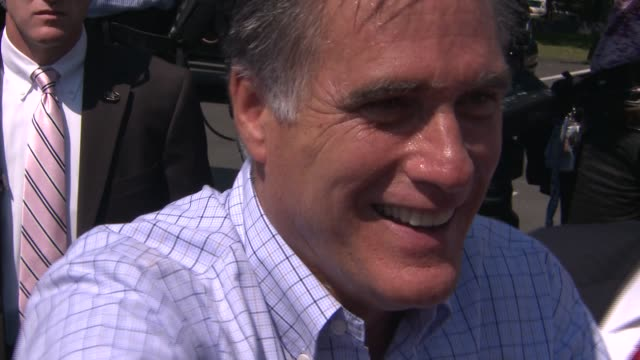 Republican presidential candidate Mitt Romney shakes hands with supporters after rally in swing state Virginia Mitt Romney shakes hands at Van Dyck...
