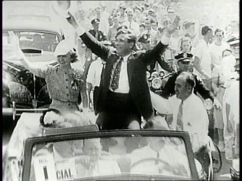 republican presidential nominee wendell willkie and wife edith in the back of a convertible parading waving to crowds lining the street and cheering... - hometown bildbanksvideor och videomaterial från bakom kulisserna