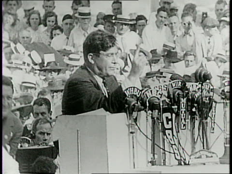 republican presidential nominee wendell willkie speaking in middle of a large crowd gathered outside in his hometown / he quiets the crowd to say... - hometown stock videos and b-roll footage