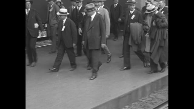 """republican us presidential candidate herbert hoover exits a train and is greeted enthusiastically by mayor james """"sunny jim"""" rolph and others; the... - presidential candidate stock videos & royalty-free footage"""