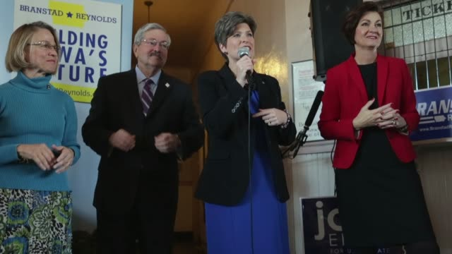 republican us senate candidate joni ernst flanked by iowa gov terry branstad and iowa lt gov kim reynolds speaks during a campaign stop at the amtrak... - usa:s senat bildbanksvideor och videomaterial från bakom kulisserna